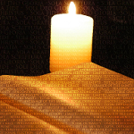 God never violates our free will - Image of Bible lit by candle light